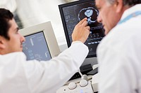 Doctors Looking at Scan on Computer