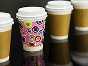 Brightly Colored Coffee Cup Among Plain Coffee Cups