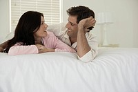 Couple lying on bed