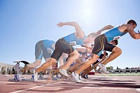 Runners emerging from starting block in multiple exposure