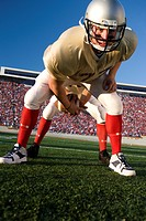 Center snapping football to quarterback (thumbnail)