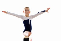 Young female gymnast 9_11 performing on balance beam, portrait
