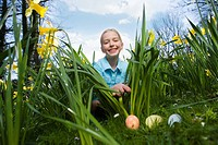 Young girl finding decorated Easter eggs