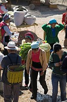 Vegetables vendor at Shaping open market, Dali, Yunnan Province, China