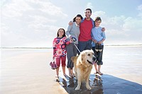Family with dog on beach
