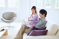Japanese Husband And Wife Who Relax On A Sofa