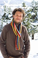 Portrait of mature mixed race man in winter setting (thumbnail)