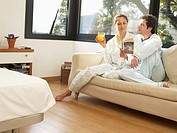 Couple sitting on sofa in morning
