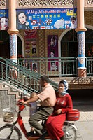 Uyghur couple on a scooter at Bazaar, Old town of Kashgar, Xinjiang Uyghur autonomy district, Silkroad, China