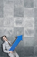 businessman holding blue arrow