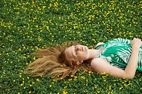 Woman Napping in a Meadow