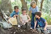 Children Digging up Buried Treasure