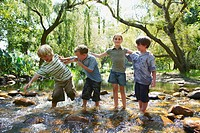 Children Standing in a Stream