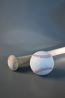 close_up of baseball bat and ball