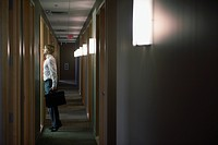 Businessman Standing in a Corridor