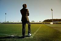 business man play soccer