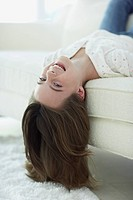 Girl Lying Upside Down on Couch