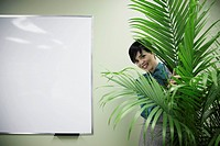 Businesswoman Behind a Plant