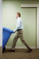 Man Taking Out Recycling