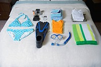 Vacation Clothes Laid Out on Bed