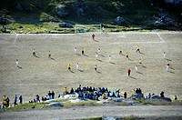 Football match on hard football ground Ammassalik Eastgreenland