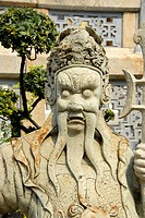 Chinese statue guard with long beard at Wat Phra Kaew Keo in the grounds of the Grand Royal Palace Bangkok Thailand