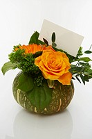 Flower arrangement in a gourd