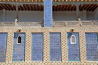 Wall decorated with fine blue maiolica below the balcony of the former harem Tash Hauli Palace Khiva Uzbekistan