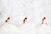 Santa Clauses sinking in snow