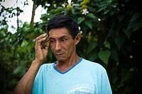 Man, Painting,Tribo Tuxaua, Cuieiras River, Amazônia, Manaus, Amazonas, Brazil