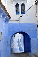 Luminous blue painted gate medina Chefchaouen Morocco