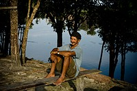 Seating man, Santa Maria Ranch, Cuieiras River, Manaus, Amazônia, Amazonas, Brazil