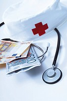 Stethoscope, nurses' cap and Euro bills: symbolic for hospital fees