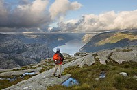 Female hiker looking out over Lyse Fjord, Rogaland, Norway, Scandinavia, Europe