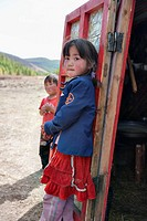 Curious Mongolian brother and sister stand in front of their ger tent or yurt home, north central Mongolia No releases available