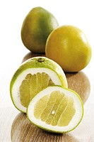 Sliced and whole pomelos (Citrus maxima)