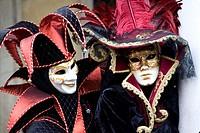 Harlequin (court jester) costume and elegant lady, Carnevale di Venezia, Carneval in Venice, Italy