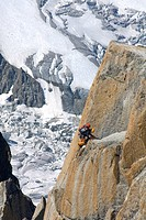 Mountain climber climbing the rockface of Mt. Aiguille du Midi, Mont Blanc Massif, Chamonix, France