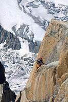 Mountain climber climbing the rockface of Mt. Aiguille du Midi, Mont Blanc Massif, Chamonix, France