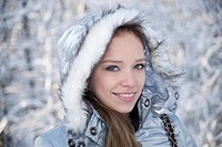 Young woman freezing in winter