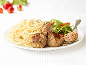 Meatballs with spaghetti and rocket & tomato salad