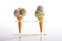 Two ice-cream cones in a stand