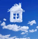 White cloud shaped as a house, blue sky