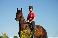 girl riding on Trakehner horse