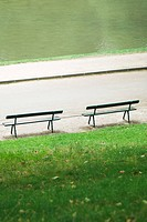France, Paris, benches facing water in park