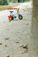Child's tricycle on gravel path