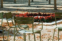 France, Paris, metal chairs in park