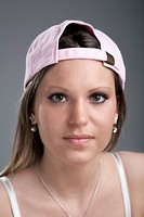 Young woman wearing a baseball cap, portrait