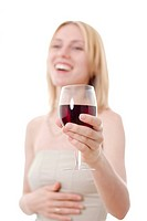 Young woman with a glass of red wine laughing