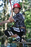 Boy climbing on the Baerenfalle Ropes Course, Immenstadt, Allgaeu, Bavaria, Germany, Europe